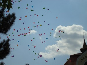 Helium balloons float above air.